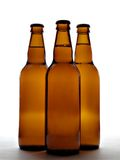 Three beer bottles. Isolated over white background stock photo