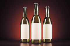 Three beer bottles. With clear logo on red background. Ad concept. Mock up, 3D Rendering Stock Photo