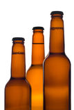 Three beer bottles (clipping path included) Stock Photos