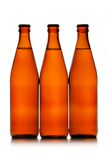 Three beer bottles in a row Royalty Free Stock Image