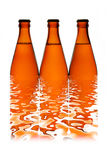 Three beer bottles in a row Stock Photos