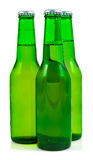 Three beer bottles in a white background Royalty Free Stock Photos