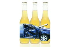 Three Beer Bottles with Wrecked Car Label Stock Photo