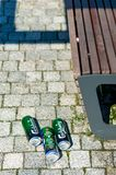 Three beer cans on the ground. royalty free stock image