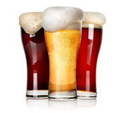 Three beers. Three sorts of beer  on a white background Stock Photography