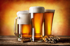 Three beers and wheat Stock Image