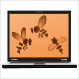 Three bees on the screen  of the notebook Stock Photo