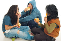 Three beggars sharing a bread Royalty Free Stock Photos