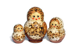 Three beige and brown matrioshkas Royalty Free Stock Images