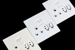 Three Beige and White Multipurpose Wall Mount Sockets Stock Image