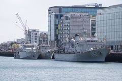 Three Belgian Navy ships berthed together on the River Liffey in Dublin, Ireland. royalty free stock image