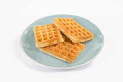 Three belgian waffles on a blueish plate, isolated on white Stock Photo