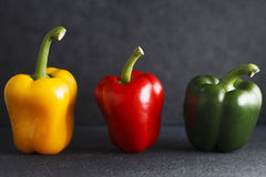 Three bell peppers on Limestone surface. Stock Photo