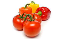 Three Bell peppers and three tomatoes Stock Photo