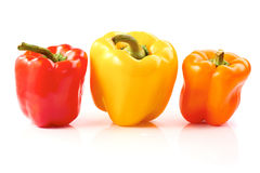 Three bell peppers on white Stock Photos