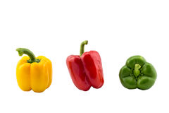 Three bell peppers yellow red green isolated on white background. Picture royalty free stock image
