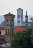 Towers of Florence. Three campanile of Florence ... Campanile di Giotto(White one) , Campanile della Badia Fiorentina (peaked roof) , Campanile of small local Royalty Free Stock Photography
