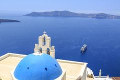 Three bells of Fira Church in Fira, Santorini island, Greece royalty free stock photography