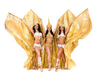 Three belly dancers with golden wings Royalty Free Stock Photo