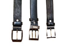 Three belts with metal buckles. It is isolated on white background Stock Photography