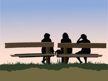 Three on a bench Stock Images