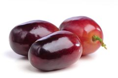 Three berries of red grapes close up. Stock Images