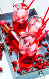 Three berry cocktail with liquor and ice on a tray . Royalty Free Stock Images