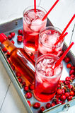 Three berry cocktail with liquor and ice on a tray . Stock Images