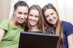 Three Best Caucasian Girlfriends Sitting Together Embraced with stock photography
