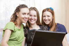 Three Best Caucasian Girlfriends Sitting Together Embraced with Stock Images