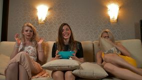 Three best friend woman on bed watching a tv. Three best friend woman on bed watching a tv with pop corn. Horror moment frightened pretty girls. They afraid and stock video