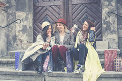 Three best friends enjoying after shopping. Stock Images