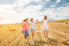 Three best friends having fun outdoors. On a sunny day Royalty Free Stock Images