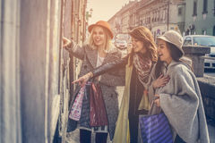 Three best friends in the shopping. Royalty Free Stock Photo