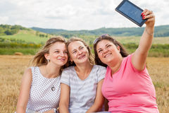 Three best friends taking a selfie. Outdoors Stock Photography