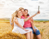 Three best friends taking a selfie. Outdoors Royalty Free Stock Photography
