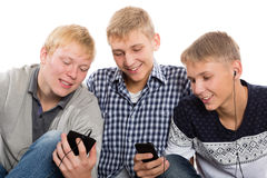 Three best friends use smartphones Royalty Free Stock Photo