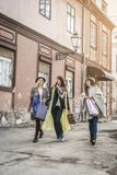 Three best friends walking on the street . Three best friends re Stock Photography