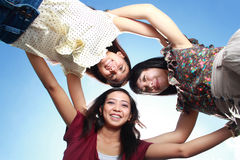 Three best girlfriends having fun under the sun Stock Image