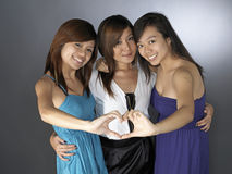 Three Best Girlfriends posing with each other stock photos