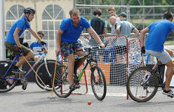 Three bicycle polo players Royalty Free Stock Images