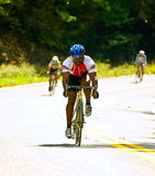 Three Bicycle Riders Stock Photography