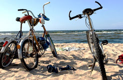 Three bicycles on a sandy beach of Baltic sea Royalty Free Stock Photo