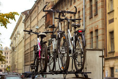 Three bicycles, family travel. Family travel. Three bicycles are transported on the trunk of the car Royalty Free Stock Image