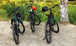Three bicycles for forest cycling parked royalty free stock photo