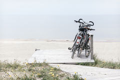 Three bicycles parked on empty beach Royalty Free Stock Photography
