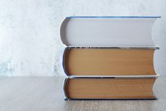 A stack of  books with copy space. Three big books symbolizing education and study stock photography