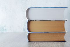 A stack of  books with copy space. Three big books symbolizing education and study stock images