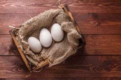 Three big fresh goose eggs in a box, copyspace Royalty Free Stock Photography