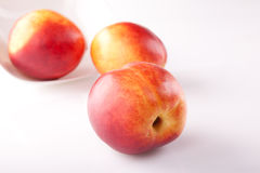 Three big fresh ripe peaches Royalty Free Stock Photo